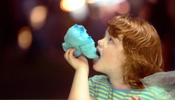 Photo Brittany Randolph/The Star Erin Lewis, 6, enjoys cotton candy while watching games at the Ellenboro Fair on Tuesday. The fair will run until Saturday, September 9th at the old Ellenboro School.